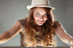 Mysterious enigmatic intriguing woman girl in hat. Portrait of mysterious enigmatic woman in studio on grey. Young intriguing attractive girl in hat. Shining Royalty Free Stock Photos