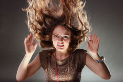 Mysterious enigmatic woman girl with flying hair. Royalty Free Stock Images