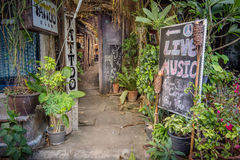 Mysterious entrance to a hippie tattoo bar in Thailand. Entrance to a hippie style tattoo saloon, Tongsala, Thailand Stock Photo