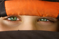 Mysterious eyes. Eyes of a child (boy) watching you from his hiding stock photos