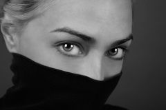 Mysterious eyes. Cloaked in shadow of silence Royalty Free Stock Photography