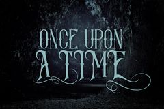Free Mysterious Fairy Tale Background Of Dark And Haunted Forest With Text. Royalty Free Stock Photo - 125858545