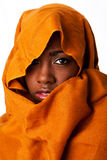 Mysterious female face in ocher head wrap royalty free stock images
