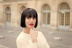 Free Mysterious Female Has Idea. Girl Fashionable Lady With Bob Hairstyle Outdoor Urban Architecture Background. Woman Stock Images - 145611654