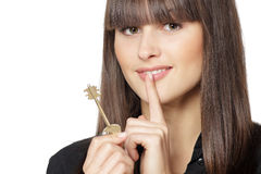 Mysterious female holding house key Royalty Free Stock Photos