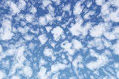 Mysterious fluffy white clouds in blue summer sky Royalty Free Stock Photography