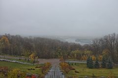 Mysterious foggy autumn morning. Panorama of Kyiv from the Park of Fame Park of Glory Stock Image