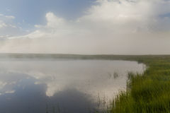Mysterious foggy lake Royalty Free Stock Photography