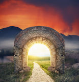 Mysterious gate sunny entrance.  New life or beginning concept. Mysterious gate dreamy sunny entrance.  New life or beginning concept Royalty Free Stock Image