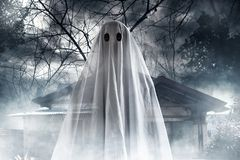 Mysterious ghost on haunted house. At night stock image