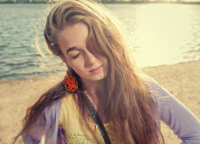 Mysterious girl alone on aseashore Royalty Free Stock Photography