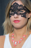 Mysterious girl. A girl with a black lace mask carnival Royalty Free Stock Image