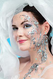 Mysterious girl with creative face art Stock Photos