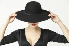 Mysterious girl in a hat royalty free stock image