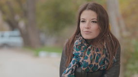 Mysterious girl stands under falling leaves stock footage