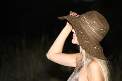 Mysterious girl in summer hat Royalty Free Stock Photos