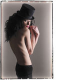 Mysterious girl in top hat. Royalty Free Stock Images