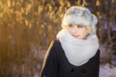 Mysterious girl in a  winter evening Park look at the sky Royalty Free Stock Photos