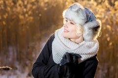 Mysterious girl in a winter evening Park look at the sky royalty free stock photography