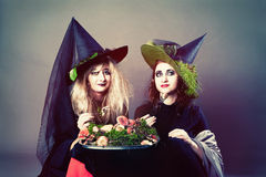 Mysterious girls in the dark suits. On Halloween witches Stock Photography