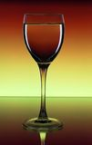 Mysterious glass with wine Royalty Free Stock Photo