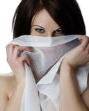 Mysterious green. Woman covering her face with a sheer Royalty Free Stock Images