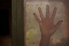 Mysterious hand on a window Royalty Free Stock Images