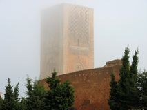 Mysterious Hassan Tower in the fog, Rabat, Morocco. The old tower of medieval mosque in Rabat, Morocco royalty free stock photos