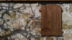 A mysterious hiding place in a stone wall. On a clear day Royalty Free Stock Images
