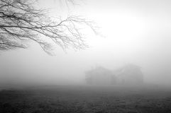 Mysterious house in the forest with fog Royalty Free Stock Photo