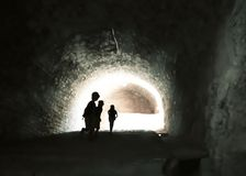 Mysterious image of ghostlike children in an obscure cave. Stock Image