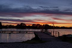 A mysterious landscape with a pier after sunset at Kalwa lake. A mysterious landscape after sunset at Lake Kalwa in Masuria in Poland. On the first plan there is royalty free stock images