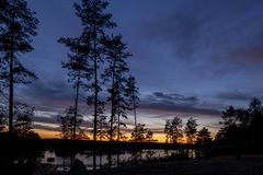 A mysterious landscape after sunset at Kalwa lake. A mysterious landscape after sunset at Lake Kalwa in Masuria in Poland. In the foreground you can see the royalty free stock image