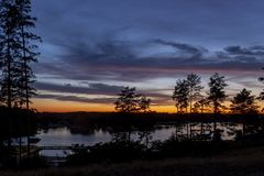 A mysterious landscape after sunset at Kalwa lake. A mysterious landscape after sunset at Lake Kalwa in Masuria in Poland. In the foreground you can see the stock photos