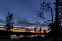 A mysterious landscape after sunset at Kalwa lake. A mysterious landscape after sunset at Lake Kalwa in Masuria in Poland. In the foreground you can see the stock image