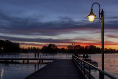 A mysterious landscape with a pier after sunset at Kalwa lake. A mysterious landscape after sunset at Lake Kalwa in Masuria in Poland. On the first plan there is stock photo