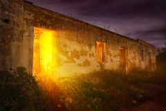 Mysterious light in abandoned house Stock Photos