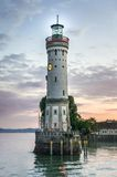 Mysterious lighthouse at evening in harbor of Lindau in lake Con Stock Photo