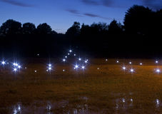Mysterious Lights. Unidentified lights at night in a field royalty free stock photography