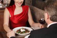 Mysterious look. Top view of loving couple dinning at the restau Royalty Free Stock Photography