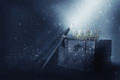 mysterious and magical image of old crown, wooden chest stock photography