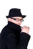 Mysterious man. Wearing a black hat and a black coat with a raised collar Stock Photography