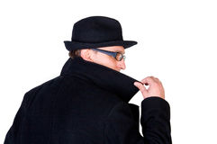 Mysterious man. Hiding his face behind a raised collar stock images