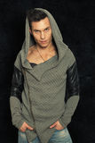Mysterious man with hood. Portrait fashionable man Stock Image