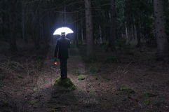 Mysterious man and the lighting umbrella 2 Royalty Free Stock Photo