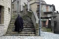 Mysterious man on stairs Stock Photography