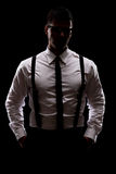 Mysterious man standing in the dark Royalty Free Stock Images