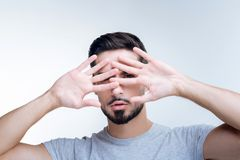 Shy young person hiding his face from unknown people Royalty Free Stock Photography