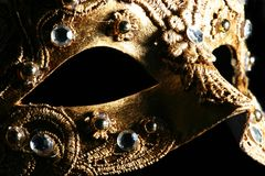 Mysterious mask... Detail of a richly decorated venetian mask Stock Photos