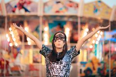 Woman Wearing carnival Mask at Funfair Amusement Park Royalty Free Stock Photo